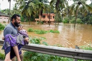 People being rescued from a flood-affected region following heavy monsoon rainfall, in Kochi on Thursday, Aug 16, 2018.