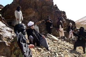 "aliban fighters pose during a patrol in Ghazni province in January 2010. The leader of the Taliban said in August 2018 that there will be no peace in Afghanistan as long as the foreign ""occupation"" continues, reiterating the group's position that the 17-year war can only be brought to an end through direct talks with the United States."