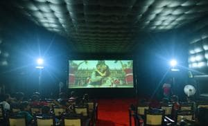 In Churu, Rajasthan, locals gather to catch a screening in a PictureTime travelling theatre. The company's 45 vans each carry an 18 ft x 7 ft screen. They tour much of central India, taking films to regions that don't have local cinema halls.