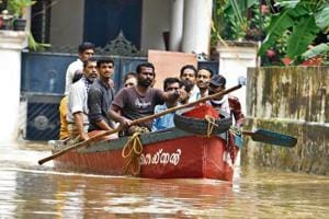 Volunteers and fisherman rescue residents from inundated Chengannur taluk in Kerala's flood-hit Alappuzha district on Sunday.