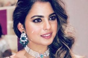 Isha Ambani's delicate gown featured various 3D floral and wildlife appliques — including butterflies. Scroll to see photos. (Instagram)
