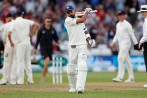 Virat Kohli reacts after losing his wicket during the third Test between India and England at Trent Bridge.