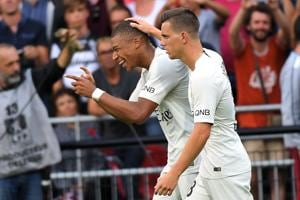 French forward Kylian Mbappe (L) celebrates with Paris Saint-Germain