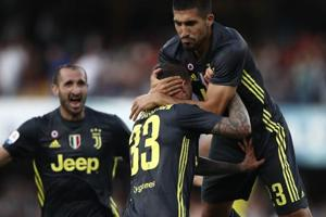 Juventus footballers celebrate during their Serie A encounter against Chievo.