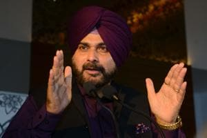 Punjab Cabinet Minister Navjot Singh Sidhu sparked major controversy after being shown seated next to the president of Pakistan Occupied Kashmir (PoK) at Pakistan Prime Minister Imran Khan's swearing-in and hugging Pakistan army chief Gen Qamar Javed Bajwa.