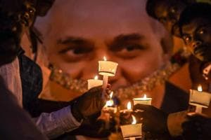 BJP members hold candles to pay tribute to former prime minister Atal Bihari Vajpayee in Bengaluru on Friday. Former prime minister Atal Bihari Vajpayee's 'Asthi Kalash Yatra' will touch every village panchayat in the state, chief minister Shivraj Singh Chouhan announced on Saturday