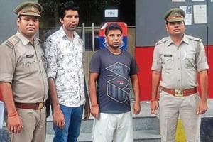 Noida Police arrested gunner Rahul Nagar (second from left) on Sunday.