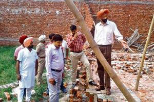 Officials at the collapse site in Fatehgarh Sahib on Sunday.
