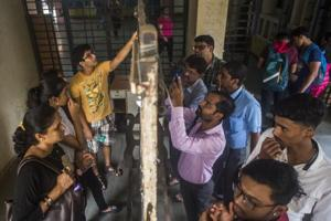 Students and parents check the first merit list of FYJC at Ruia college, Matunga in Mumbai, India.