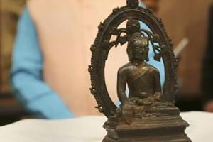 The ancient Buddha statue displayed at the High Commission of India in London Wednesday, Aug. 15, 2018, during a ceremony to hand it back to India, 57-years after it was stolen from an Indian museum and found its way to UK