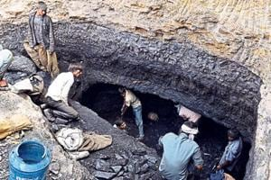 A group of villagers dig out coal from the hillside of Mahan forest in Singrauli district of Madhya Pradesh.