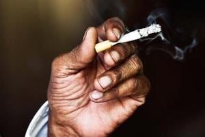 About 275 million of India's adult population use tobacco in some form or another.