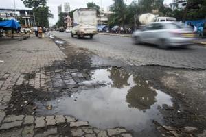 Potholes near Mahim station in Mumbai on Monday.