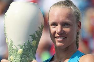 Kiki Bertens of the Netherlands holds the trophy after defeating Simona Halep of Romania during the women's final.