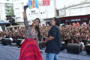 Kajol and Riddhi Sen take a selfie with students of Narsee Monjee in the background while promoting Helicopter Eela there.