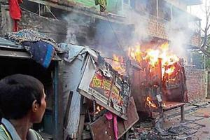 Roadside stalls and houses are set on fire by an irate mob in Bihiya town of Bhojpur district on Monday evening.
