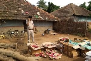 Police officials inspecting explosives seized at Shahpur village in Pakur district on Monday, August 20, 2018.
