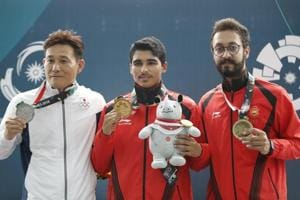 Saurabh Chaudhary (C) on Tuesday became only the fifth Indian shooter to claim a gold in the Asian Games history, beating a field of multiple world and Olympic champions in the 10m air pistol finals in Palembang, Indonesia.
