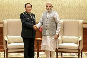 Prime Minister Narendra Modi shakes hands with defence minister of China, General Wei Fenghe during a meeting in New Delhi on August 21.