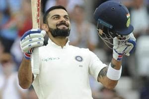 Virat Kohli celebrates after scoring a century during Day 3 of the third Test match between India and England at Trent Bridge.