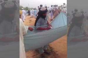 In one video, two men are holding up a sheet of cloth containing a sizeable amount of cash as a third man, speaking in a mix of Urdu and Pashto, asks people attending the Eid prayers to contribute for the 'jihad by Muslims' against the 'kafir' forces in America and India.