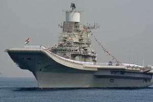 Indian Navy personnel stand on the INS Vikramaditya, a modified Kiev-class aircraft carrier, during the International Fleet Review in Visakhapatnam on February 6, 2016.