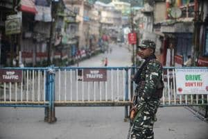 Paramilitary forces stand guard along a road during a strike called by the Gorkha Janmukti Morcha for separate state Gorkhaland in Kalimpong on September 3, 2017.
