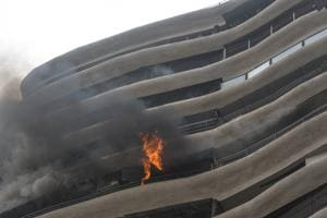 Four people died in Wednesday's fire at Crystal Tower, where several safety rules were violated.