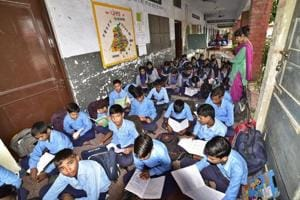 Students attending classes in a corridor of Government High School in Ludhiana's Sunet.