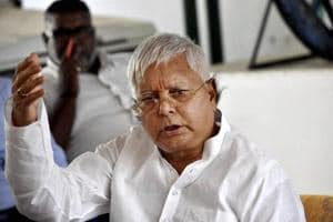 RJD chief Lalu Prasad addresses a press conference in Patna.