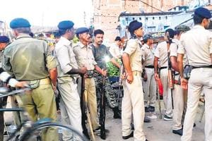Security personnel at Bihiya in Bihar's Bhojpur where a woman was thrashed and paraded naked on suspicion of her involvement in a teen's death.  Protesters also set ablaze a number of roadside stalls, houses besides motorcycles.