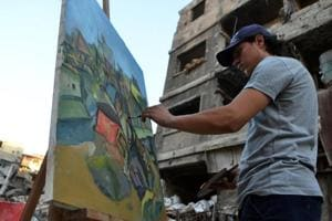 Photos: In Syria's Yarmuk, painters translate suffering into art