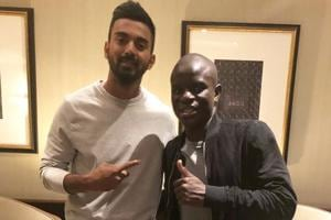 Indian cricket team's KL Rahul poses with Chelsea footballer N'golo Kante in London.
