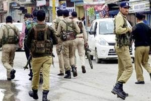 In this file photo, personnel of the Jammu and Kashmir Police search for militants who attacked a BSNL telecom franchise at Sopore.