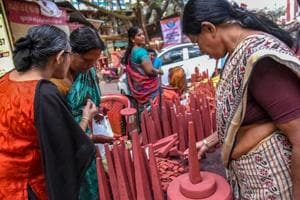 A vendor selling 'Thrikkakara Appan', the most important of Onam celebration at Kochi in Kerala on Friday.