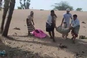 A grab taken from a AFPTV video on August 25, 2018 shows men carrying covered bodies in Al-Durayhimi, some 20 kilometers (12 miles) south of Hodeida, after a missile strike for which the Huthi rebels and a Saudi-led coalition fighting them traded blame.