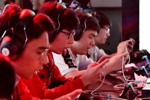 """The Indian team battles against Laos at the eSports """"Arena of Valor"""" tournament as a exhibition sport at the 2018 Asian Games."""