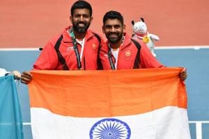 Divij Sharan (R) and Rohan Bopanna (L) pose for photographers during the medal ceremony at the Asian Games 2018.