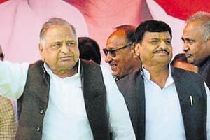 Samajwadi Party founder Mulayam Singh Yadav with his brother and senior leader Shivpal Singh Yadav in Etawah.