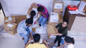 Students of Jai Hind pack essentials for distribution at a relief campo in Kerala