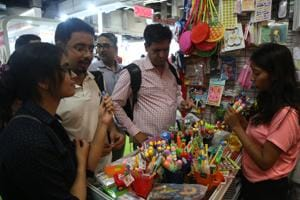 Visitors bargain for a better deal at one of the stalls in hall number 7 of Pragati Maidan.