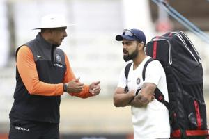 India head coach Ravi Shastri, left, speaks with Virat Kohli during the nets session.