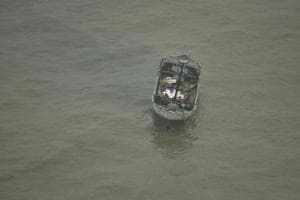 An Indian fishing boat  in the Arabian Sea is seen after the fishermen were rescued in Thiruvananthapuram. Six fishermen swam to safety while one was missing after their boat capsized in the Arabian Sea off the Uttan coast Thane, police said on Monday.