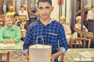 Delivery boy Sohail Hussain works at an Irani cafe and enjoys visits the highrises which offer a bird'seye view of the city.