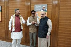 BJP president Amit Shah along with Chhattisgarh chief minister Raman Singh and former Raipur collector OP Choudhary on August 28.