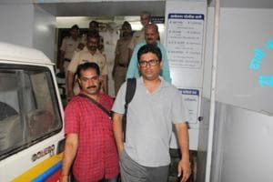 Arun Pereira (in grey), a human rights activist and lawyer, arrested by Pune Police on Tuesday.