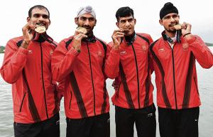 (From left) The Indian men's team comprising Sawarn Singh, Dattu Bhokanal, Om Prakash and Sukhmeet Singh won the gold medal in the men's quadruple sculls event.