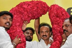 Dravida Munnetra Kazhagam supporters garland the newly-elected party chief MK Stalin in Chennai on Tuesday.