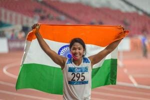 Indian athlete Swapna Barman celebrates after winning the gold medal in the women