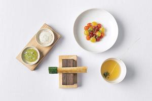 Eleven Madison Park in New York serves tomato dosa with green tomato relish and aged-goat cheese